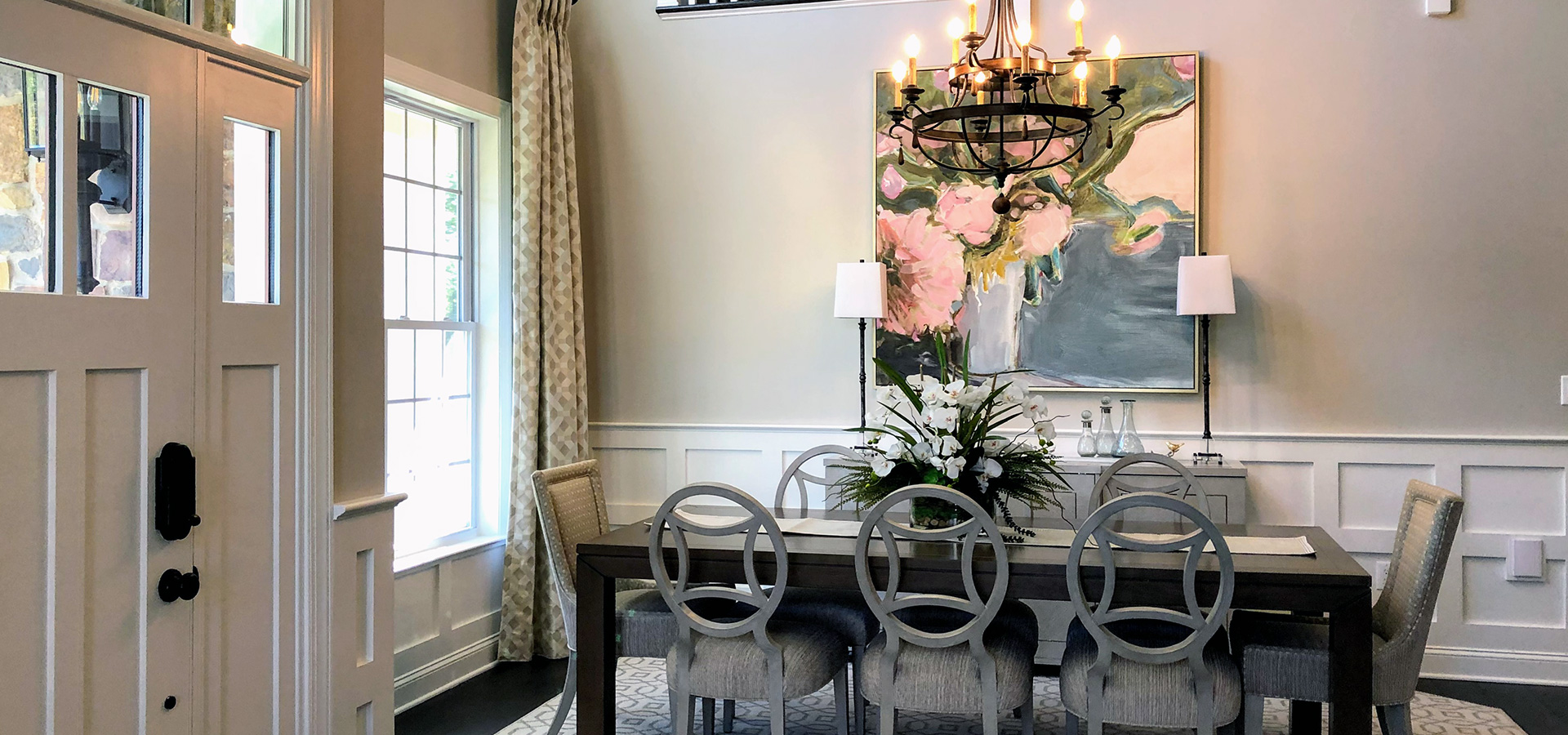 dining room with art and chandelier